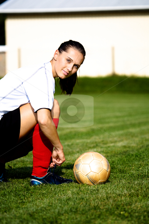 Soccer girl stock photo, Female soccer player on the field by Val Thoermer