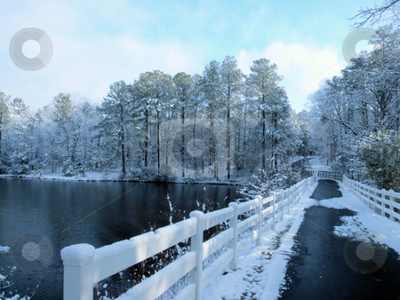 Bridge over winter lake stock photo, A bridge over a lake during the winter time. by Tim Markley