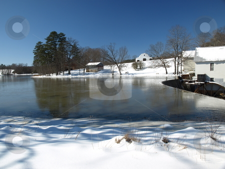 Cold day at the mill stock photo, Cold day a a rural mill and pond by Tim Markley