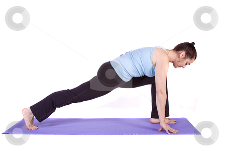 Woman in Yoga Position stock photo,  by Mehmet Dilsiz