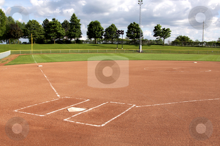 Softball Diamond stock photo, A view of a softball diamond at dusk. by Chris Hill