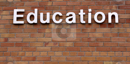 Education on a Brick Wall stock photo, The word education on a brick wall. by Chris Hill