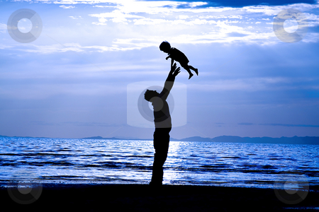 Father and Son  stock photo, Father andSson on the Beach - Silhouette Shot by Mehmet Dilsiz