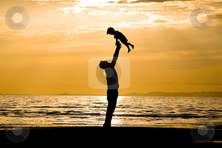 Father and Son  stock photo, Father and son on the Beach - Silhouette by Mehmet Dilsiz