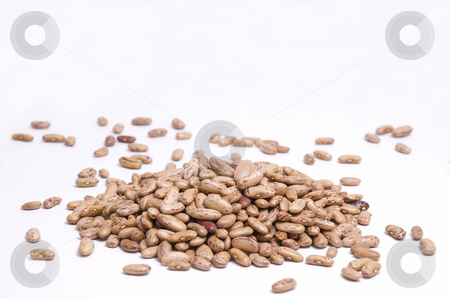 Pinto beans pile stock photo, Large pile of pinto beans isolated on white by Olivia Neacsu
