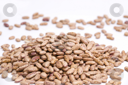 Heap of pinto beans stock photo, Macro on a big heap of pinto beans by Olivia Neacsu