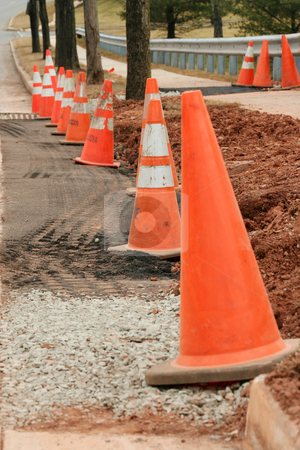 Construction cones stock photo, Orange construction safety cones on a street by Jim Mills
