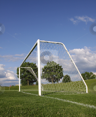 Vertical Soccer Net stock photo, A view of a net on a vacant soccer pitch. by Chris Hill