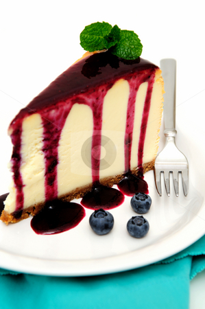 Cheesecake stock photo, Plain Cheesecake with a Blueberry sauce poured over the top with fresh berries on the plate next to the cake and topped with a mint leaf. by Lynn Bendickson