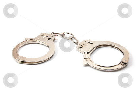 Handcuffs  stock photo, Police handcuffs isolated on a white background by Gunnar Pippel
