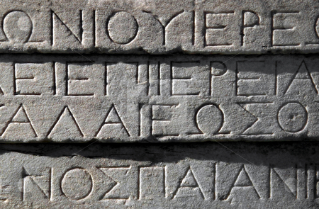 Ancient Greek writing stock photo, Ancient Greek writing engraved on Parthenon building, Athens, Greece. by Martin Crowdy