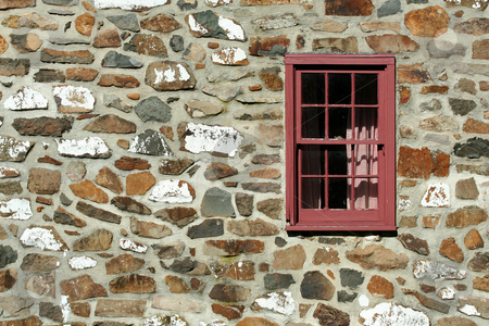 Old stone house with window stock photo, A Old stone house with window by Jim Mills