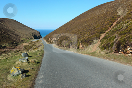 Narrow road to Chapel Porth beach in Cornwall UK. stock photo, Narrow road to Chapel Porth beach in Cornwall UK. by Stephen Rees