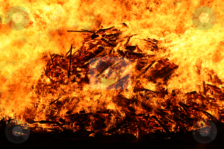 Bonfire stock photo, Large bonfire at its peak by Jon Helgason