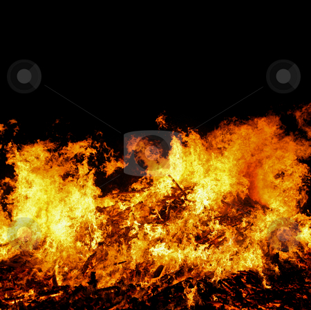 Large bonfire stock photo, Fire blazing through bonfire. High shutterspeed to freeze the movement of the flames 1/2500. by Jon Helgason