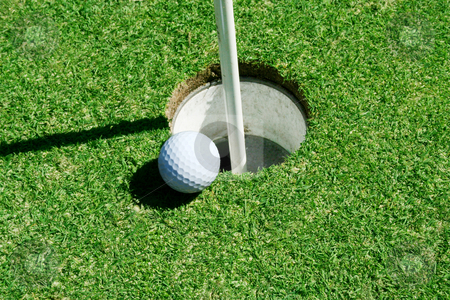 Golf Ball on green near hole stock photo, A Golf Ball on green near hole with flag pole by Jim Mills