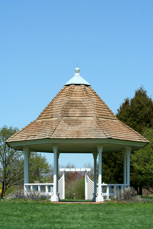 White gazebo in a park with blue sky stock photo, A White gazebo in a park with blue sky by Jim Mills