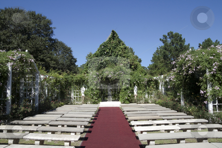 Outdoor Wedding Chapel stock photo, A outdoor wedding chapel surrounded by green vines by Kevin Tietz
