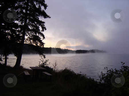 Algonquin Morning Fog stock photo, Early morning fog rising on a lake in Algonquin provincial park in Ontario, Canada. by Chris Hill