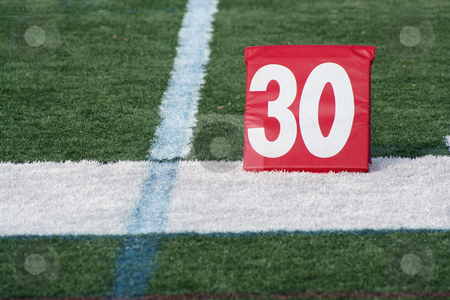 Football thirty yard marker stock photo, A red Football thirty yard marker by Jim Mills