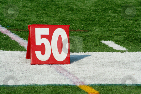 Football fifty yard marker stock photo, A red Football fifty yard marker by Jim Mills