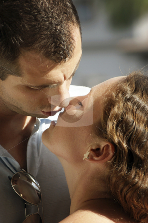 Close up of sexy young couple aboout to kiss in the afternoon su stock photo, Close up of sexy young couple aboout to kiss in the hot afternoon sunshine with their lips parted ready to meet by Stephen Orsillo