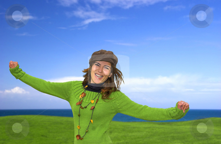 Happy woman stock photo, Happy woman in a great beautiful landscape by ikostudio