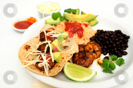 Shrimp Taco Plate stock photo, Shrimp cooked in Jamaican spices for tacos with black beans and Spanish rice, lime cilantro, cheese and hot sauce. by Lynn Bendickson