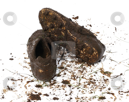Muddy football shoes after the game stock photo, Muddy and dirty football cleats isolated on white by Jon Helgason