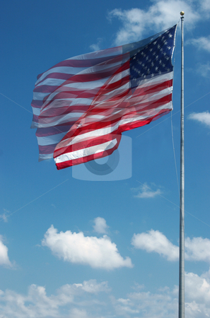 Large american flag waving in the wind stock photo, Sequence photo of stars and stripes waving in the wind on a sunny day by Jon Helgason