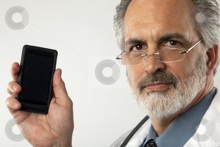 Doctor Holding up Cell Phone stock photo, Portrait of a doctor wearing glasses and a white lab coat.  He is holding up a cell phone and looking at the camera. Horizontal shot. by Edward Bock