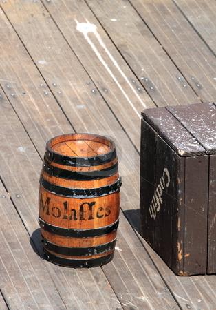 Barrel stock photo, Wood barrel standing standing on a wooden pier by Henrik Lehnerer