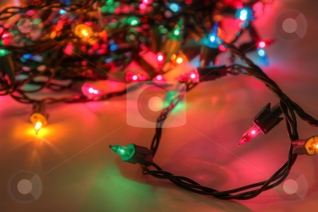 Multi-Colored Light String stock photo, An HDR (high dynamic range) shot of a muli-colored Christmas light string. by Chris Hill