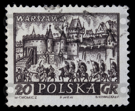 Medieval town of Warsaw with hussar cavalry stock photo, POLAND, circa 1960 - medieval town of Warsaw, Polish capitol,  with hussar winged cavalry on a vintage, canceled post stamp, dark brown engraving on white by Marek Uliasz