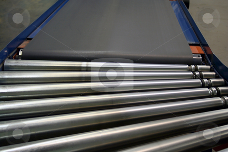 Conveyor Rollers and belt stock photo, An image of some Conveyor Rollers and belt by Jim Mills
