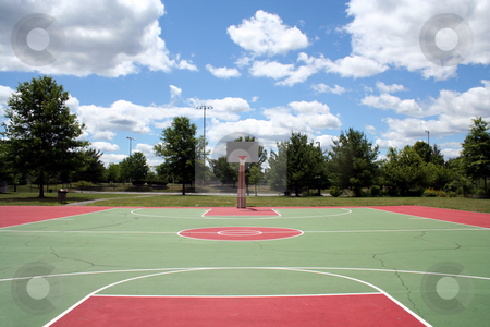 Basketball Court stock photo, An image of a Basketball court against a cloudy sky by Jim Mills