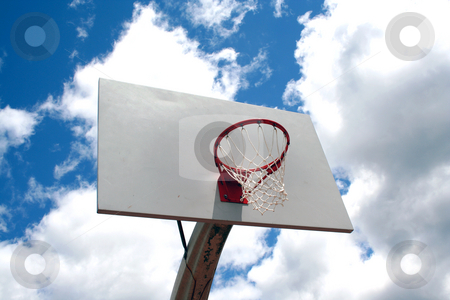 Basketball hoop against sky stock photo, An image of a Basketball hoop against a cloudy sky by Jim Mills