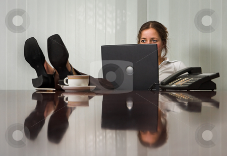 Relaxed stock photo, Young woman with laptop in meeting room, with her feet on the table by Anneke