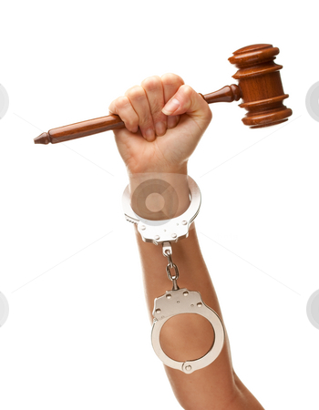Handcuffed Woman Holding Wooden Gavel on White stock photo, Handcuffed Woman Holding Wooden Gavel in Her Fist Isolated on a White Background. by Andy Dean