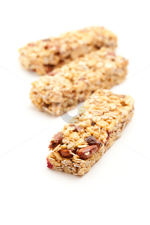 Three Granola Bars Isolated on White stock photo, Three Granola Bars Isolated on a White Background with Narrow Depth of Field. by Andy Dean