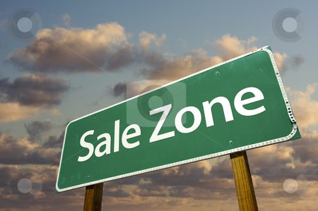 Sale Zone Green Road Sign and Clouds stock photo, Sale Zone Green Road Sign In Front of Dramatic Clouds and Sky. by Andy Dean
