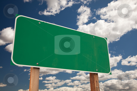 Blank Green Road Sign Over Clouds stock photo, Blank Green Road Sign on Dramatic Blue Sky with Clouds - Ready for your own message. by Andy Dean
