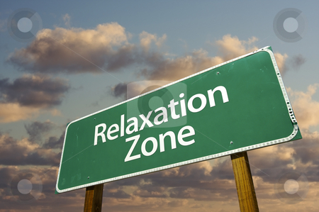 Relaxation Zone Green Road Sign and Clouds stock photo, Relaxation Zone Green Road Sign In Front of Dramatic Clouds and Sky. by Andy Dean