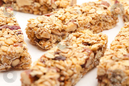 Several Granola Bars Isolated on White stock photo, Several Granola Bars Isolated on a White Background with Narrow Depth of Field. by Andy Dean