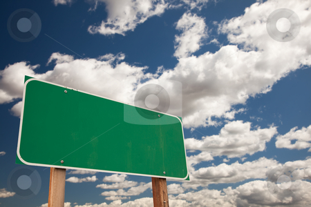 Blank Green Road Sign Over Clouds with Text Room stock photo, Blank Green Road Sign on Dramatic Blue Sky with Clouds - Plenty of Room For Your Own Text. by Andy Dean