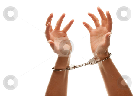 Handcuffed Woman Raising Hands in Air on White stock photo, Handcuffed Woman Desperately Raising Hands in Air Isolated on a White Background. by Andy Dean