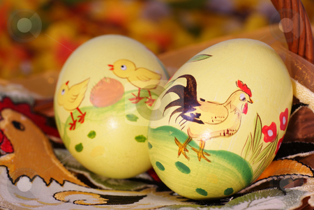 Easter eggs stock photo, Two colourful eggs on napkin with cock by Jolanta Dabrowska