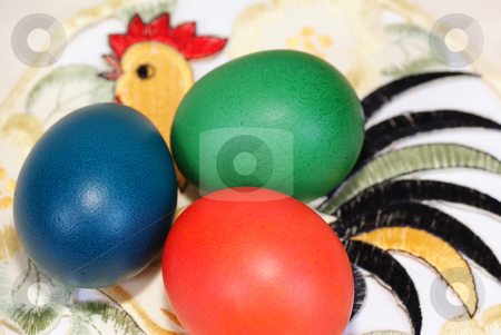 Easter eggs stock photo, Three colourful eggs on napkin with cock by Jolanta Dabrowska