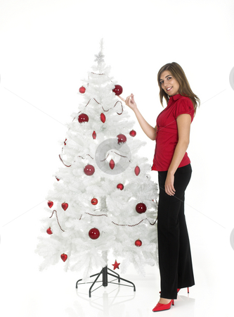 Christmas beauty stock photo, Beautiful attractive woman posing near a white Cristmas tree by ikostudio