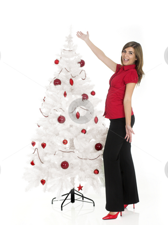 Christmas beauty stock photo, Beautiful attractive woman posing near a white Christmas tree by ikostudio